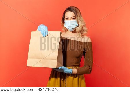 Stay Home, Shopping Safe. Woman In Protective Mask And Gloves Holding Paper Bag, Food Purchase Deliv