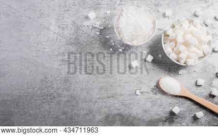 World Diabetes Day Awareness Concept. Top View Of Sugars In A Bowl And Spoon, A Symbol Of Diabetic C