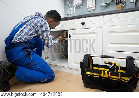 Plumber Fixing Kitchen Pipes. Water Sink Service