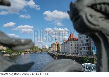 Berlin Germany - August 26 2017; View Through Decorative Railing Of Ebert Bridge Across River Spree