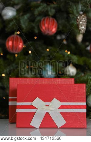 Christmas Presents.surprises And Gifts For The Winter Holidays. Red Boxes On Christmas Tree Backgrou