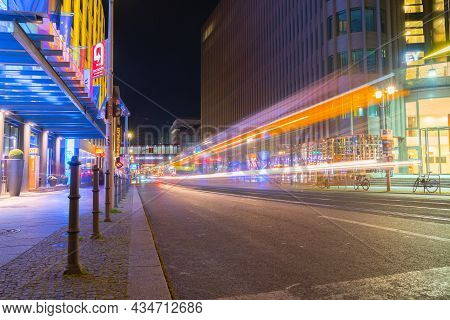 Berlin Germany - August 25 2017; Friedrichstrasse At Night Illuminated By Street Lights And Neon Sig