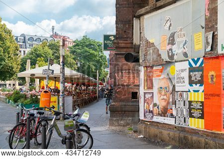 Berlin, Germany - August 27 2017; Old Grimy Building On Corner With Bills Posted On Wall , Bicycles