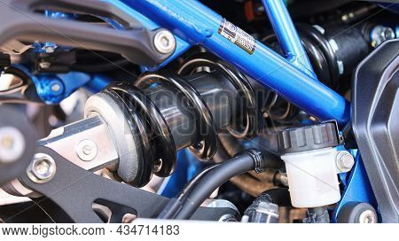 Close Up Motorcycle Shock Absorber. Spring And Hydraulic Shock Absorber Oil Cylinder The System Help