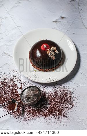 Chocolate Mousse With Berries And Cocoa Powder On A Dark Background. Top View. Flat Lay.