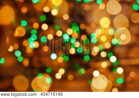 Glowing Magic Bokeh. Defocused Lights Background. Defocused Gold Lights. Abstract Holiday Background