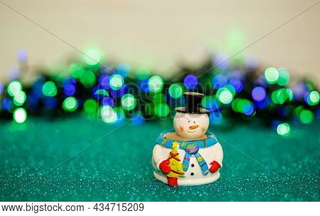 Festive Snowman With Christmas Light Background. Merry Christmas And Happy New Year Greeting Card. S