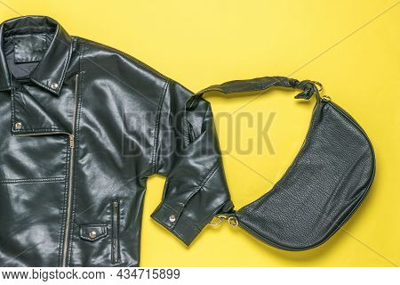 Bag And Bag Made Of Black Leather On A Yellow Background. Stylish Women's Set. Flat Lay.