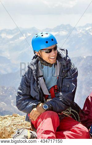 Close Up Portrait Of Smiling Climber In Helmet On High Mountain, Fann, Pamir Alay, Tajikistan