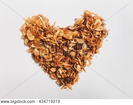 Pile Of Onion Fries Or Shallots With Shape Like Heart Or Love Isolated White Background.