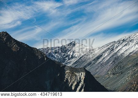Picturesque Mountain Landscape With Snowy Pointy Top In Sunshine Under Cirrus Clouds In Blue Sky. Co