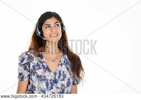 Woman In Call Center Tele Phone Marketer Looking Up Copy Space Isolated On White Background