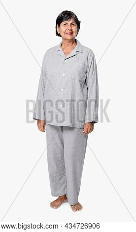 Senior woman in gray pajamas nightwear apparel full body