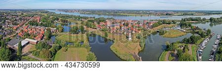 Aerial panorama from the historical city Woudrichem at the Merwede in the Netherlands