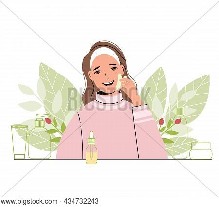 Young Woman Takes Care Of Her Face. She Uses Gua Sha Jade Scraper For Massage. Chinese Skin Care Con