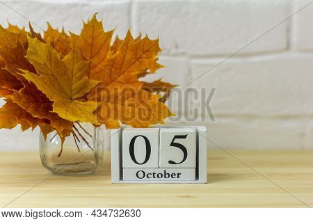 October 5 On The Calendar And A Bouquet Of Bright Autumn Leaves On The Table.one Of The Days Of The