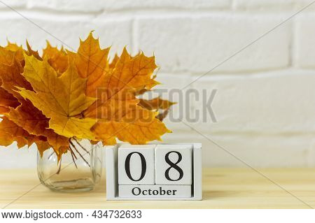 October 8 On The Calendar And A Bouquet Of Bright Autumn Leaves On The Table.one Of The Days Of The
