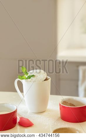 Cake In A Mug In White Cup, Baking Ingredients On White Kitchen Table, Baking At Home With Kids, Des