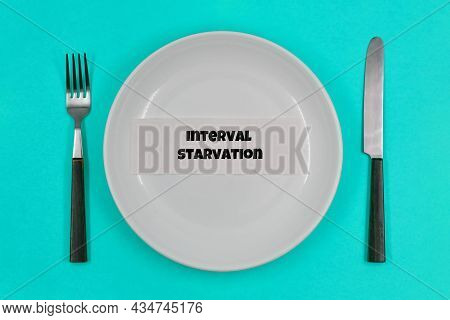 Concept, Table Setting, Empty White Plate With Fork And Knife On Blue Background, With One Of The Pr