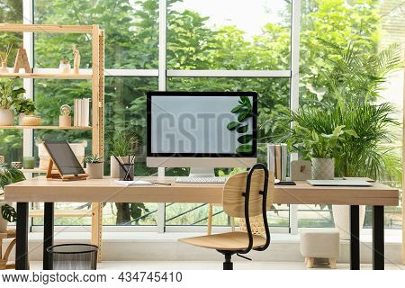 Comfortable Workplace With Computer In Light Room. Interior Design
