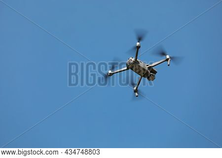 Modern Drone Against Blue Sky, Low Angle View. Space For Text
