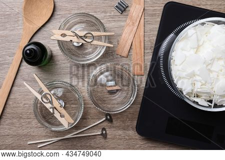Flat Lay Composition With Ingredients For Homemade Candles On Wooden Background