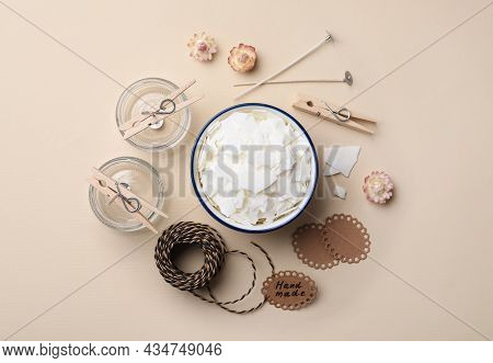 Flat Lay Composition With Ingredients For Homemade Candles On Beige Background