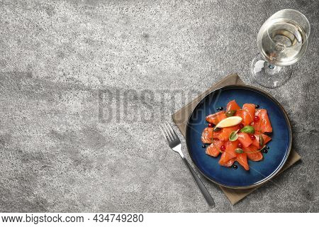 Salmon Carpaccio With Capers, Cranberries, Basil And Lemon Served On Grey Table. Space For Text