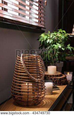 Burning Scented Candles On Wooden Console Table In Room