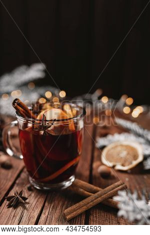 Christmas Time Concept Photo. Glass Cup Or Mug With Mulled Wine Inside On Wooden Table, Background.