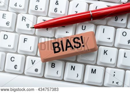 Hand Writing Sign Bias. Business Approach Inclination Or Prejudice For Or Against One Person Group A