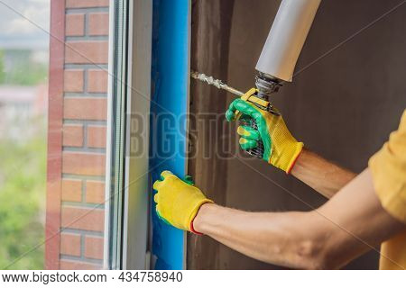Builder Or Handyman Is Engaged In The Repair Or Installation Of Windows