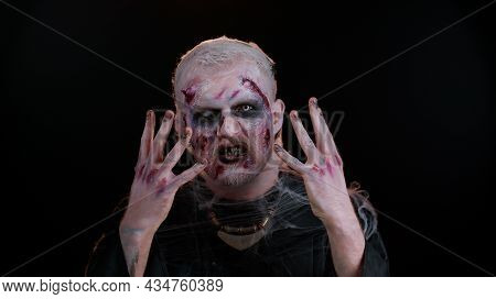 Creepy Man With Bloody Scars Face, Halloween Stylish Zombie Make-up. Scary Wounded Undead Guy Making