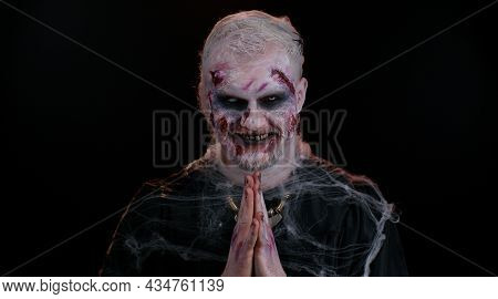 Sly Cunning Sinister One Man In Costume Of Halloween Crazy Zombie With Bloody Wounded Scars Face Try