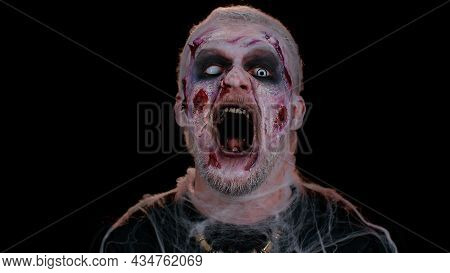 Unexpected Appearance Of Frightening Man With Halloween Zombie Bloody Wounded Make-up, Trying To Sca