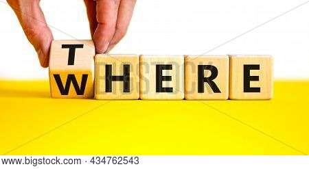 There Or Where Symbol. Businessman Turns A Wooden Cube, Changes The Word 'there' To 'where'. Beautif