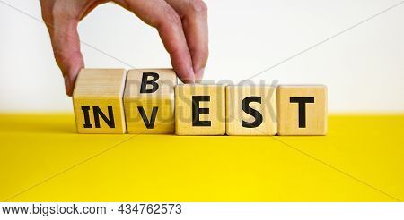 Best Invest Symbol. Businessman Turns Wooden Cubes And Changes The Word 'invest' To 'best'. Beautifu