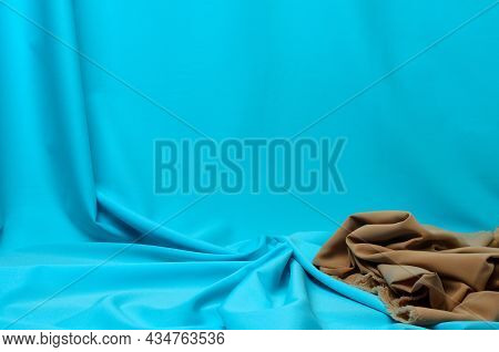 Crumpled Fabric In Pale Blue And Beige With Elegant Pleats For The Background.