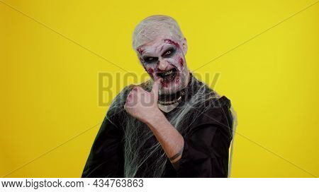 Creepy Man With Scary Halloween Zombie Makeup In Costume Raises Thumbs Up Agrees With Something Or G