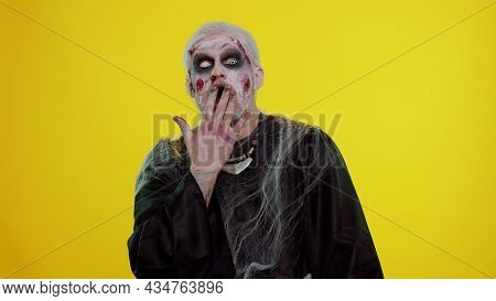 Oh My God, Wow. Scary Man With Halloween Zombie Bloody Wounded Makeup Raising Hands In Surprise Look