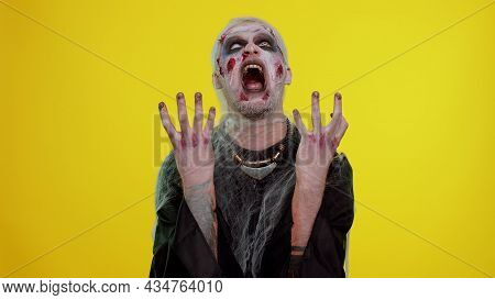 Dissatisfied Spooky Man With Halloween Zombie Bloody Wounded Makeup Asking Reason Of Failure, Expres