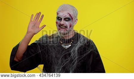 Creepy Man With Bloody Scars Face, Halloween Zombie Make-up. Scary Wounded Undead Guy Smiling Friend