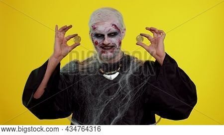 Creepy Man With Bloody Scars Face, Halloween Zombie Showing Golden Bitcoins. Achievement Career Weal