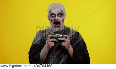 Spooky One Man With Horrible Scary Halloween Zombie Makeup Enthusiastically Playing Racing Drive Vid