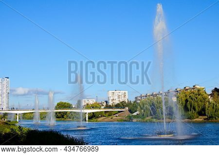 Picturesque Autumn Landscape Of Rusanovka Neighborhood At Sunny Day. Fountains In The City Channel.