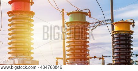 Three Detail Of High Voltage Circuit Breaker In A Power Substation On Blue White Cloud Sky.high Volt