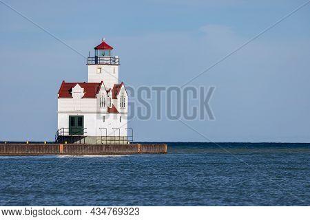 Kewaunee Pierhead Lighthouse On A Breakwater Along Lake Michigan