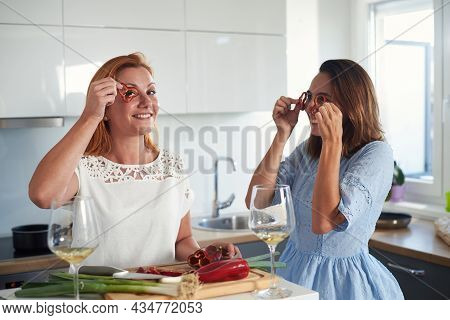 Woman cooking food in kitchen.Young woman cooking food in kitchen using tablet computer to learn. Cooking food lifestyle. Cooking food. Beautiful woman cooking food at home. Lifestyles. Healthy food.Food cooking friends lifestyle. Food