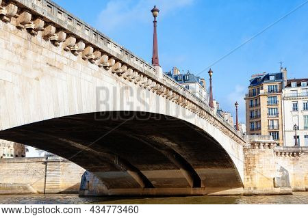 Pont De La Tournelle In Paris . Stone Bridge Over The Seine River In Paris