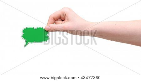 Hand holding a small speech bubble symbol
